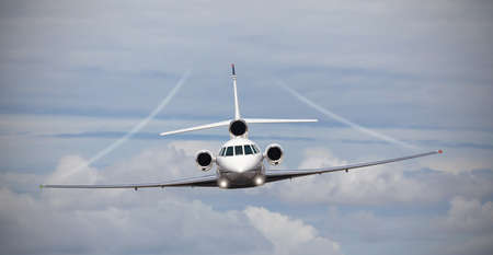 Frontal view of a private jet in midair