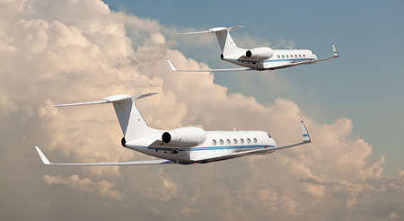 Two private jets flying side by side Stock Photo
