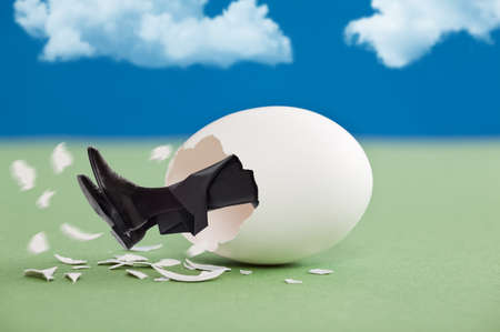 breaking out: Man breaking out of an egg