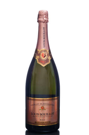 champagne region: MIAMI, USA - March 24, 2015: A bottle of Louis Bouillot, Cremant de Bourgogne Rose - Perle dAurore. French sparkling rose made in the Champagne method from the region of Burgundy. Editorial