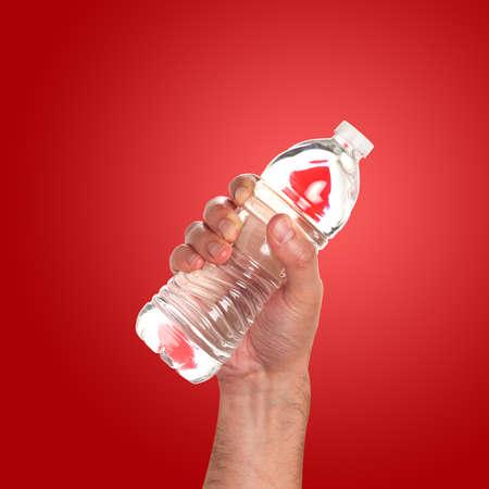 gulp: Hand holding a bottle of water