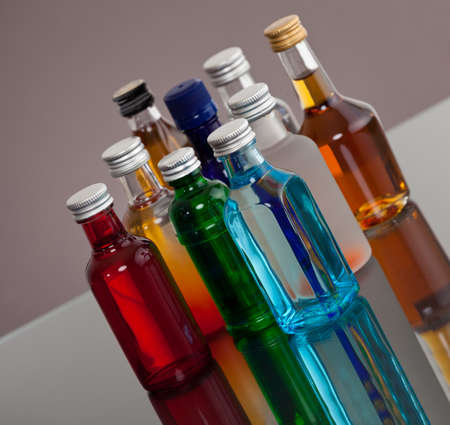 vodka: Group of colorful bottles Stock Photo