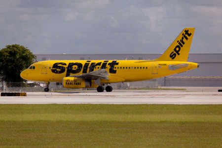 in low spirits: FORT LAUDERDALE, USA - May 24, 2015: A Spirit Airlines Airbus A320 taxiing at the Fort LauderdaleHollywood International Airport, Florida. Spirit Airlines has its operating base in Fort Lauderdale. Editorial
