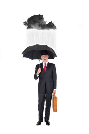 grouchy: Business man with a rainy black cloud over him