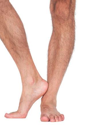 feet naked: Nude mans legs isolated on white background Stock Photo