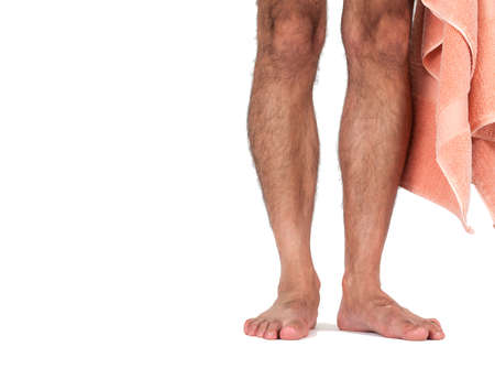 feet naked: A mans naked legs standing with towel