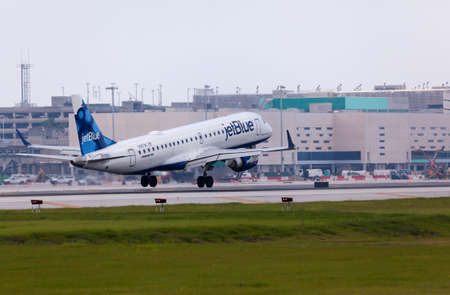 jetblue: FORT LAUDERDALE, USA - May 24, 2015: A Jetblue Airlines Embraer 190 aircraft landing at the Ft. LauderdaleHollywood International Airport, Florida.