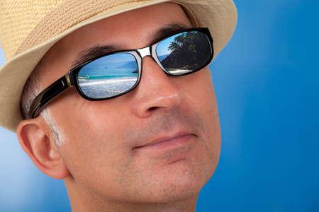 Close up of a man's face wearing sunglasses 版權商用圖片