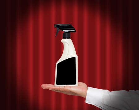 spot light: Hand holding a bottle under a spot light