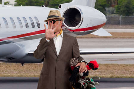 Business man shielding his face from photographers