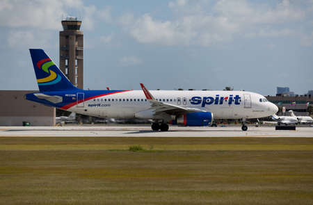 in low spirits: FORT LAUDERDALE, USA - JUNE 2, 2015: A Spirit Airlines Airbus A320 taxiing at the Ft. LauderdaleHollywood International Airport, FL. Spirit Airlines has its operating base in Fort Lauderdale.