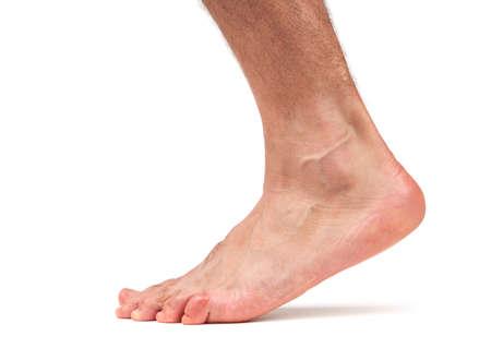 Bare male foot walking