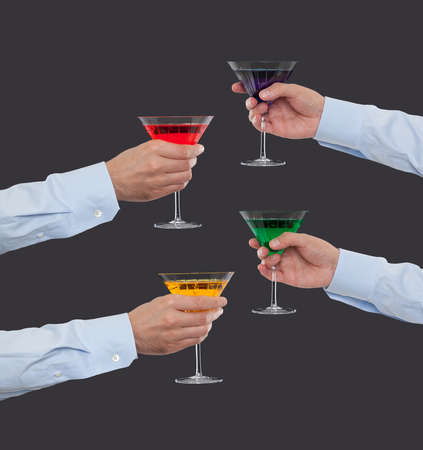 four hands: Four hands holding cocktails Stock Photo
