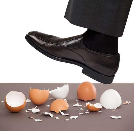 卵の殻の上を歩く男 写真素材