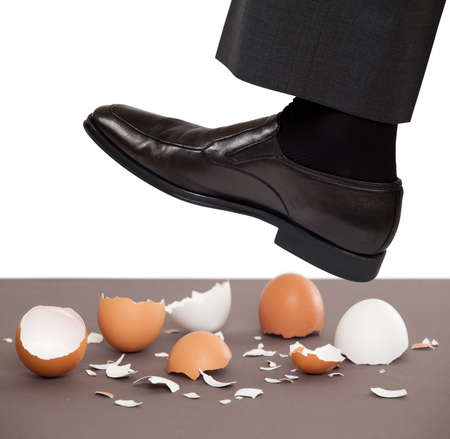 Man walking on egg shells