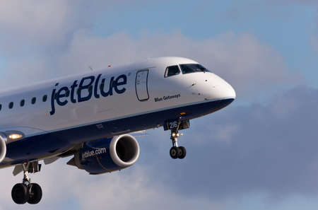 FORT LAUDERDALE, USA - May 30, 2015: A Jetblue Airlines Embraer 190 aircraft landing at the Ft. LauderdaleHollywood International Airport, Florida. Editorial