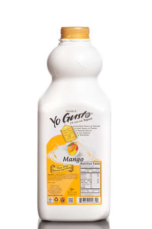 gusto: MIAMI, USA - JUNE 10, 2015: A bottle of Yo Gusto 2 low-fat yogurt mango flavored. Yogurt is an excellent source of calcium and proteins.