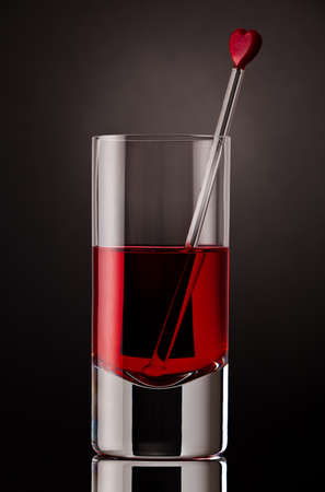 stirrer: Close up of a drink with glass stirrer