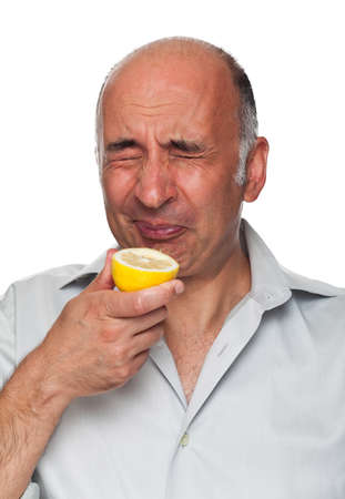 puckering lips: Man puckers after tasting a lemon Stock Photo