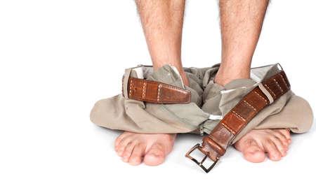 desnudo masculino: Hombre atrapado con los pantalones abajo Foto de archivo