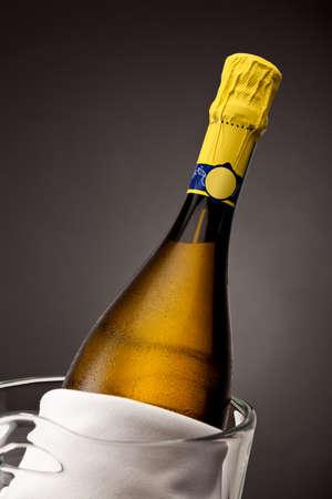 Close up of champagne bottle in glass bucket Standard-Bild