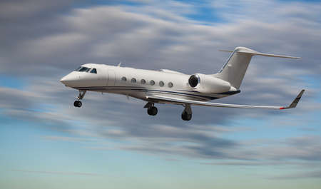Side view of a private jet flying 版權商用圖片