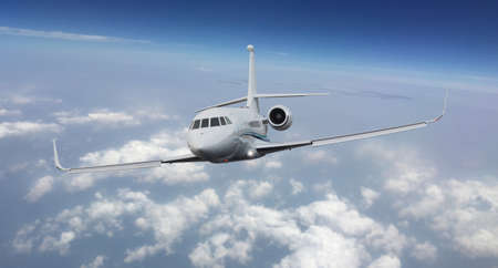 Frontal view of a private jet flying Archivio Fotografico