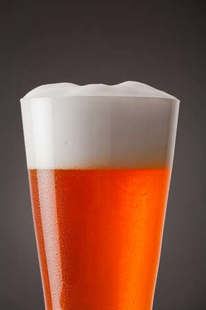 abstract liquor: Close up of a glass of beer