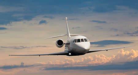 Frontal view of a private jet flying Stock Photo