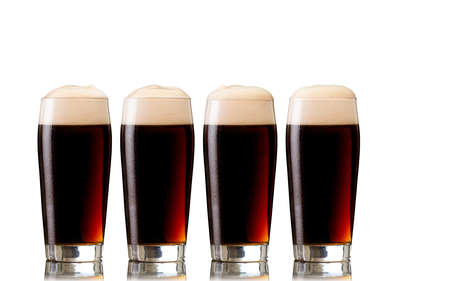 Glasses of stout beer, isolated on white
