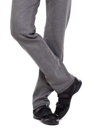 casual wear: Close up of a mans legs wearing jeans Stock Photo