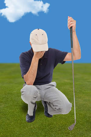 Disappointed golfer on the green