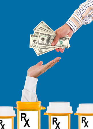 doctor money: Rising health care costs Stock Photo