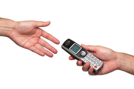 Close up of a hand passing a phone to another