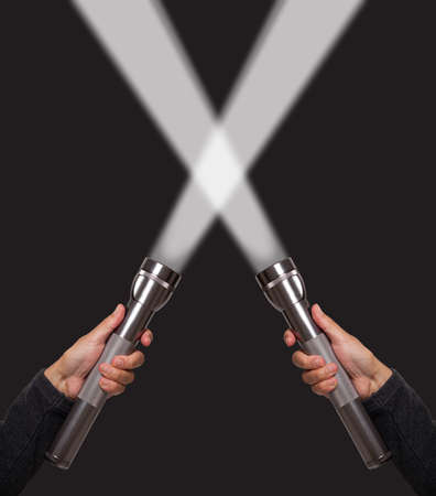 flashlights: Hands holding flashlights