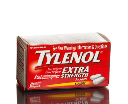 reliever: MIAMI, USA - August 31, 2015: Box of Tylenol caplets extra strength pain reliever, fever reducer.