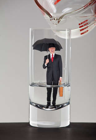 grouchy: Business man inside a glass of water Stock Photo