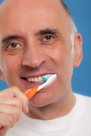 his: Handsome man brushing his teeth Stock Photo