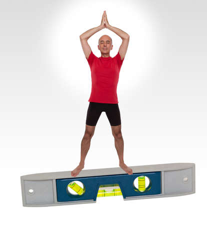 Man doing yoga standing on a level