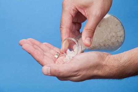 salts: Poring bath salts on a hand Stock Photo