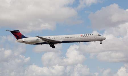 aircraft landing: MIAMI, USA - October 22, 2015: A Delta Air Lines MD-80 aircraft landing at the Miami International Airport.