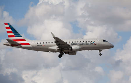 american airlines: MIAMI, USA - November 1, 2015: Embraer 175 of American Eagle Airlines landing at Miami International Airport. American Eagle Airlines is the regional partner of American Airlines.