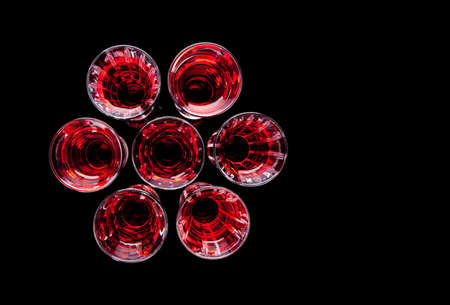 uniformity: View of beautiful crystal shot glasses from above Stock Photo