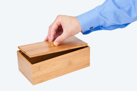 sleeve: Hand opening a wooden box