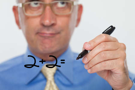 Man writing numbers on a glass board