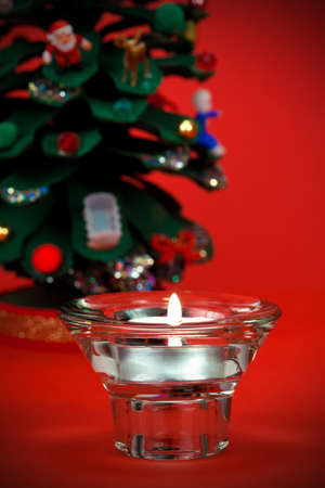 votive candle: Beautiful votive candle with Christmas detail in the background