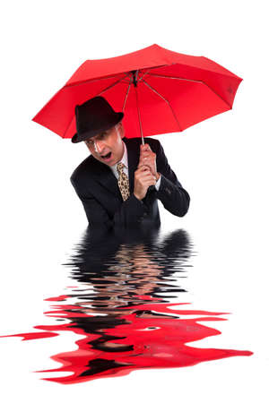 inundated: Business man with umbrella getting flooded Stock Photo