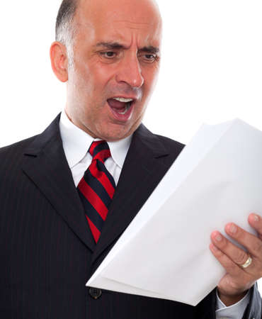 shoked: Mad business man holding pages Stock Photo