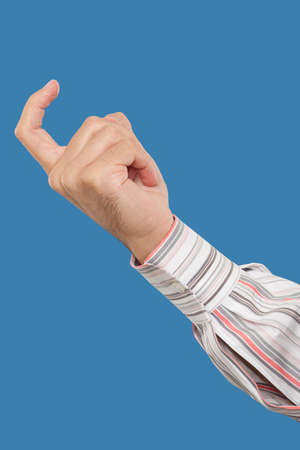 come up to: Close up of a hand gesturing with a finger come here Stock Photo
