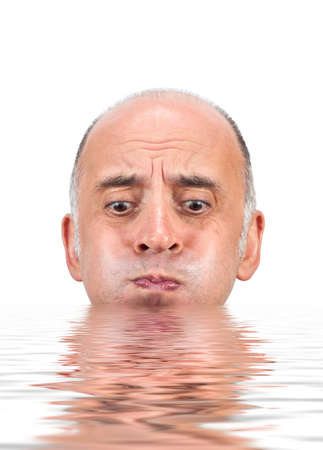 drown: Man holding his breath as he is about to drown in water Stock Photo